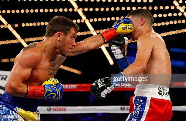 Vasyl Lomachenko left lands a left punch to the face of Roman Martinez during their Junior Lightweight WBO World Championship bout on June 11 2016 at...