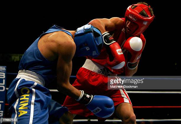 Vasyl Lomachenko of Ukraine boxes Yang Li of China during their semifinal bout in the 57kg division of the AIBA World Boxing Championships at the UIC...