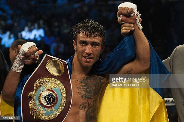Vasyl Lomachenko of Ukraine celebrates after his victory over Chonlatarn Piriyapinyo of Thailand in their WBO featherweight title boxing bout at the...