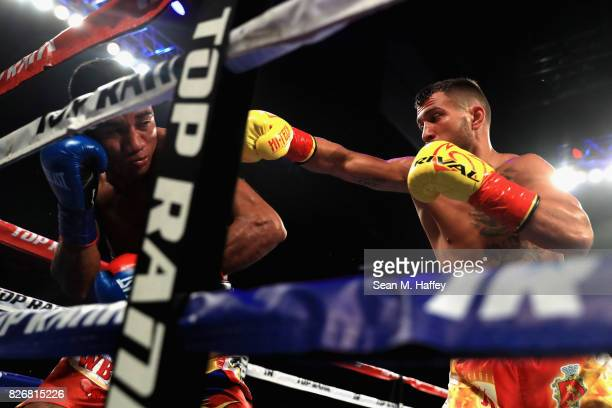 Vasyl Lomachenko of Ukraine exchanges punches with Miguel Marriaga of Columbia at during their WBO World Championship Junior Lightweight title fight...
