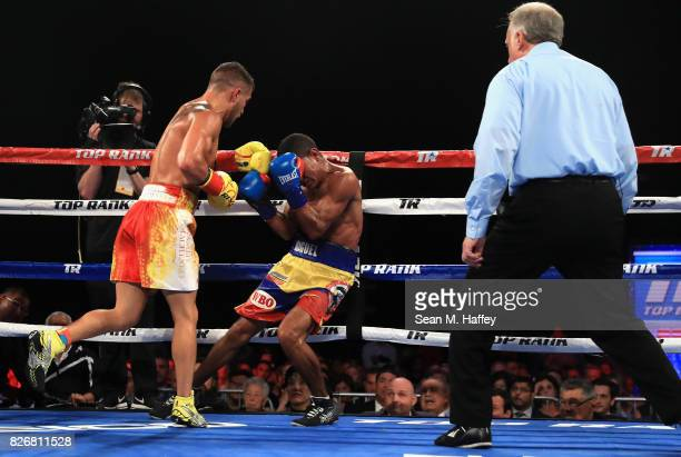 Vasyl Lomachenko of Ukraine knocks down Miguel Marriaga of Columbia at during the seventh round of their WBO World Championship Junior Lightweight...