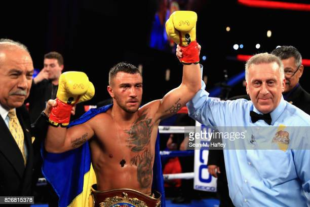 Vasyl Lomachenko of Ukraine reacts after defeating Miguel Marriaga of Columbia by TKO in the seventh round during their WBO World Championship Junior...