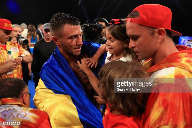 Vasyl Lomachenko of Ukraine reacts with family after defeating Miguel Marriaga of Columbia by TKO in the seventh round during their WBO World...