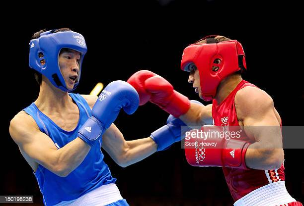 Vasyl Lomachenko of Ukraine throws a punch against Soonchul Han of Korea during the Men's Light Boxing final bout on Day 16 of the London 2012...