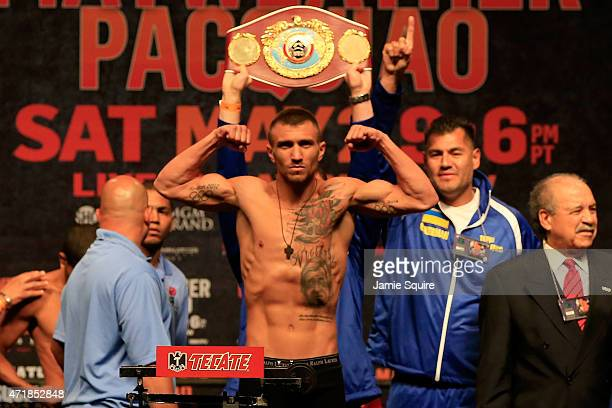 Vasyl Lomachenko poses as he steps on the scale during his official weighin for his bout against Gamalier Rodriguez on May 1 2015 at MGM Grand Garden...