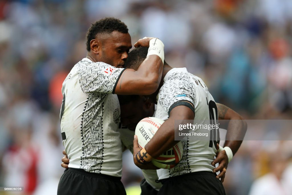 Vatemo Ravouvou, Waisea Nacuqu and Amenoni Nasilasila of Fiji celebrates at the final whistle in their Cup Final match during the HSBC London Sevens at Twickenham Stadium on June 3, 2018 in London, United Kingdom.