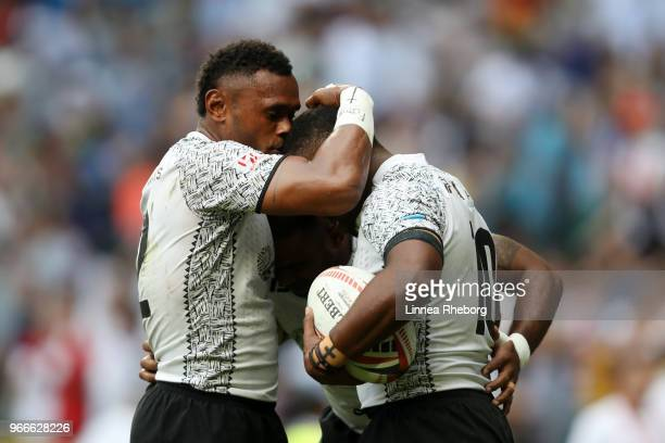 Vatemo Ravouvou Waisea Nacuqu and Amenoni Nasilasila of Fiji celebrates at the final whistle in their Cup Final match during the HSBC London Sevens...