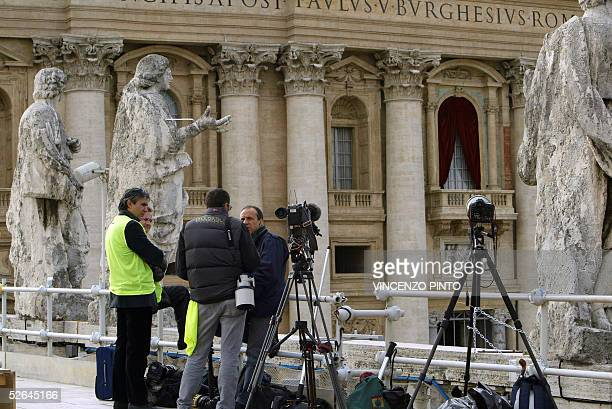 Cameramen and photographers take position on the balcony in St Peter's Square 18 April 2005 facing the window where the pope will appear once elected...