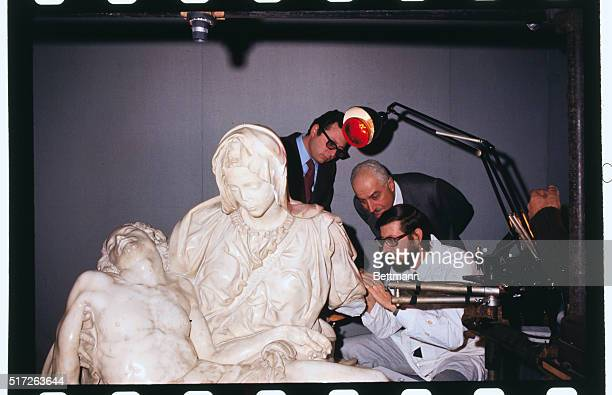 Art expert Nazarene Gabrielli checks damage to left arm of Michaelangelo's famed Pieta here The statue was smashed by a hammerwielding ma last May...
