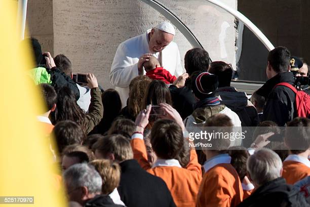 Pope Francis greets the crowd as he arrives for his general audience at St Peter's square on February 11 2015 at the Vatican Pope's concern about...