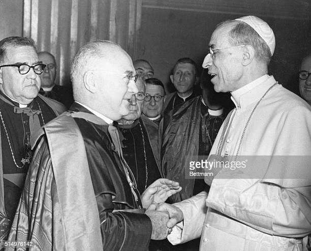 11/5/1950 Vatican City Pope Pius XII is pictured shaking hands with Cardinal Francis Spellman in the hall of benedictions in the Vatican The meeting...