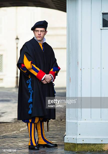 Vatican City Swiss Guard stands at his post the day before Cardinals go into conclave to chose the next Pope on March 10 2013
