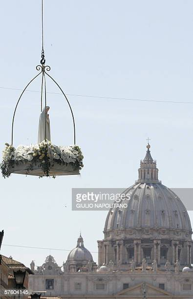 A statue of the Virgin Mary of Fatima arrives at St Angelo Castle square in Rome May 13 2006 to be carried in procession to St Peter's Square at the...