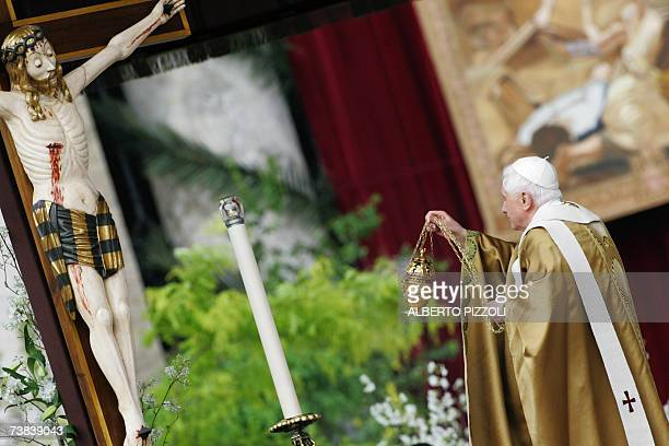CORRECTION CITY Pope Benedict XVI spreads incense in front of an effigie of Jesus Christ as he celebrates a mass on Easter Sunday the most joyous day...