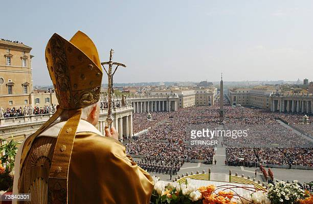 Pope Benedict XVI delivers the traditional Urbi et Orbi Easter message from the central loggia of St Peter's Basilica 08 April 2007 in the Vatican...