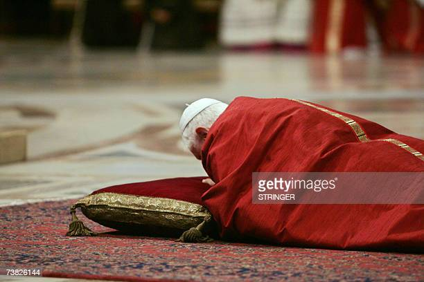 Pope Benedict XVI prays during the Good Friday service in Saint Peter's basilica at the Vatican 06 April 2007 before preside over the Stations of the...