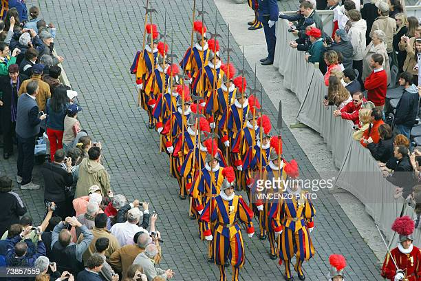 Swiss guards march past during Pope Benedict mass on Easter Sunday the most joyous day of the Christian year celebrating Christ's Resurrection 08...