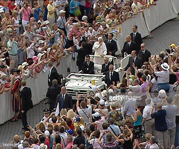 This TV grab taken from CTV TV shows an apparently deranged German man jumps a barricade and tried to board Pope Benedict XVI's open white jeep...