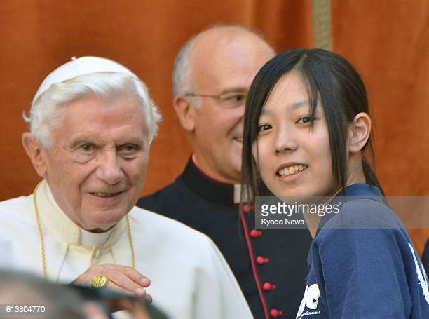 Vatican City Vatican Ena Ota a senior high school student and leader of the girls' choir MJC Ensemble and Pope Benedict XVI greet each other at...
