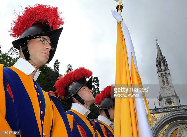 Vatican City's Swiss guards parade in front the Basilica of our Lady of the Rosary on May 25 2013 in Lourdes southern France during the opening...