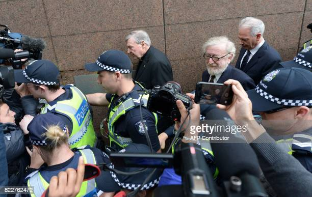 Vatican finance chief Cardinal George Pell leaves after a hearing at the Melbourne Magistrates Court in Melbourne on July 26 2017 Pell a top advisor...