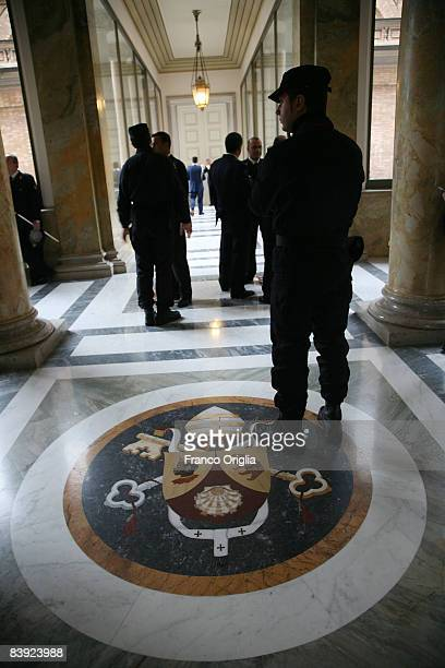 Vatican firemen walk inside the Governatorato palace before the celebration of the Vatican Fire Brigades on December 5 2008 in Vatican City