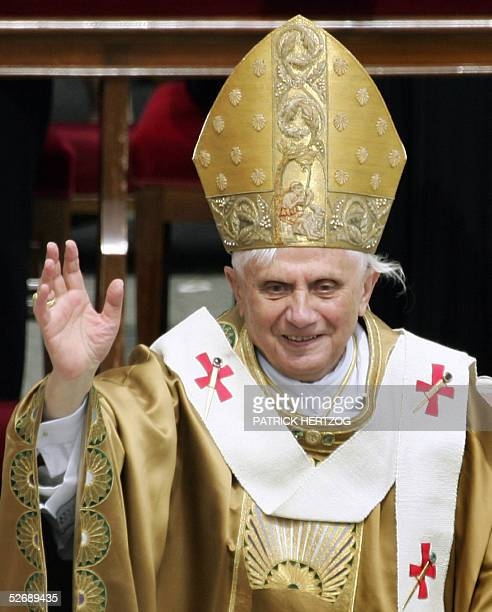 Pope Benedict XVI waves during his first mass in St Peter's Square at the Vatican 24 April 2005 Hundreds of thousands of pilgrims flocked to the...