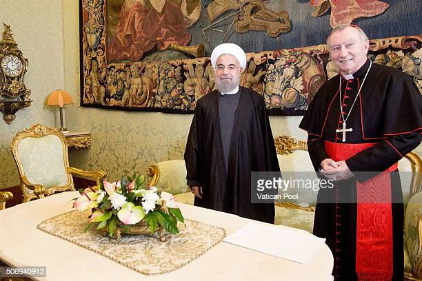 Vatican Secretary of State Cardinal Pietro Parolin meets President of Iran Hassan Rouhani after a private audience with Pope Francis at his private...