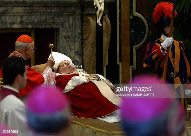 Spanish Cardinal Eduardo Martinez Somalo the Cardinal Camerlengo blesses Pope John Paul II 03 April 2005 at the Clementine Hall in the Vatican City...
