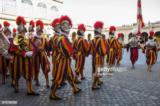 Vatican Swiss Guards march prior to a swearing in ceremony for the new 40 Swiss Guards recruits in San Damaso Courtyard in Vatican City Vatican The...