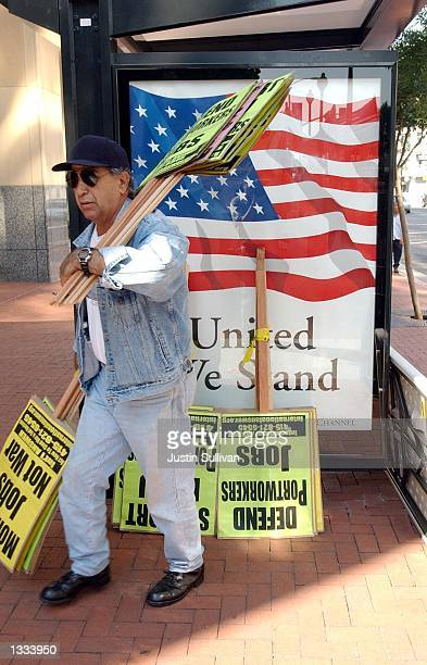 Vato a member of the Port Workers Support Committee gets signs ready for an International Longshore and Warehouse Union rally on August 12 2002 in...