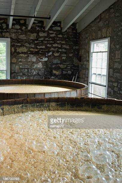 vats of new whiskey corn mash, fermentating in distillery - lexington kentucky stock pictures, royalty-free photos & images