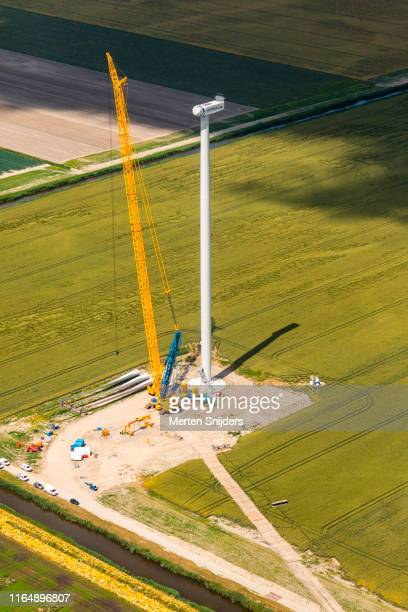 vattenfall wind turbine construction crane in middenmeer - merten snijders stock pictures, royalty-free photos & images