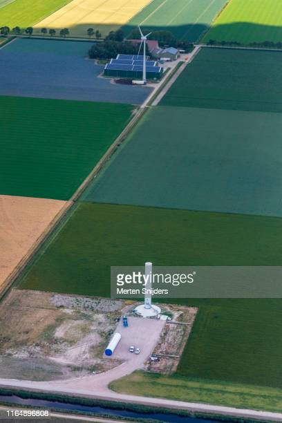 vattenfall wind turbine construction sight in middenmeer - merten snijders stock pictures, royalty-free photos & images