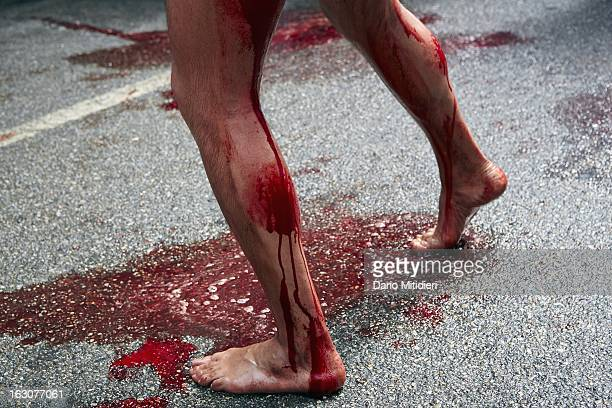 A Vattiente beats his legs with a Cardo a piece of cork containing 13 small pieces of glass in front of the statue of Madonna Addolorata in Nocera...