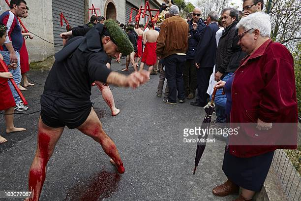 A Vattiente beats his legs with a Cardo a piece of cork containing 13 small pieces of glass during the procession of the Madonna Addolorata in Nocera...