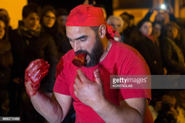 A Vattienti pray during the ritual of Vattienti that takes place on the night between Holy Thursday and Holy Friday during Holy Week in Verbicaro...