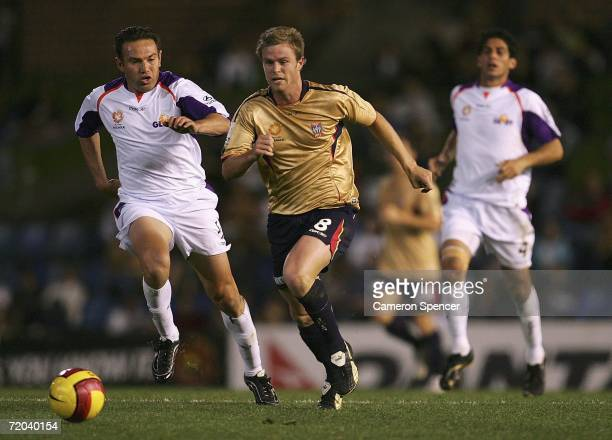 Vaughan Coveny of the Jets dribbles the ball past Stan Lazaridis of the Glory during the round six Hyundai A-League match between the Newcatle Jets...