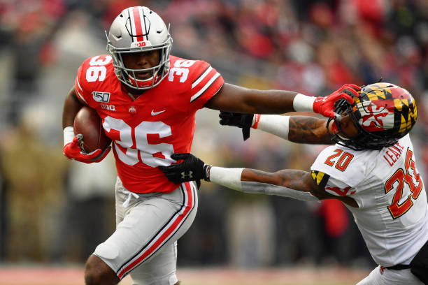 Vaughan Pope of the Ohio State Buckeyes stiff arms Javon Leake of the Maryland Terrapins after intercepting a pass in the third quarter at Ohio...