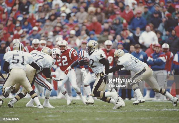 Vaughn Dunbar Running Back for the New Orleans Saints runs the ball during the American Football Conference East game against the New England...