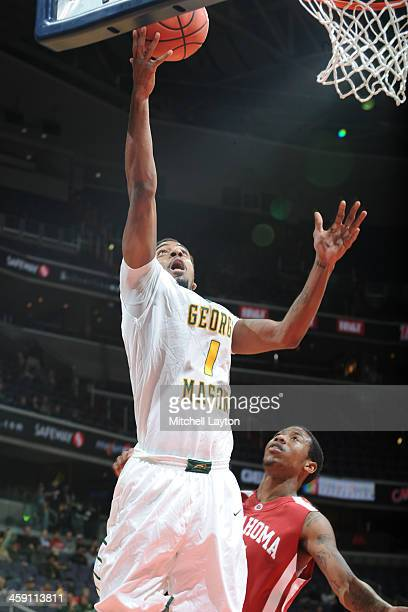 Vaughn Gray of the George Mason Patriots drives to the basketl during the BBT Classic college basketball game against the Oklahoma Sooners on...