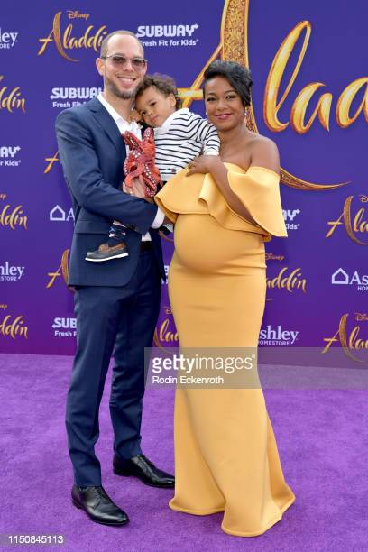 Vaughn Rasberry Edward Aszard Rasberry and Tatyana Ali attend the premiere of Disney's Aladdin at El Capitan Theatre on May 21 2019 in Los Angeles...