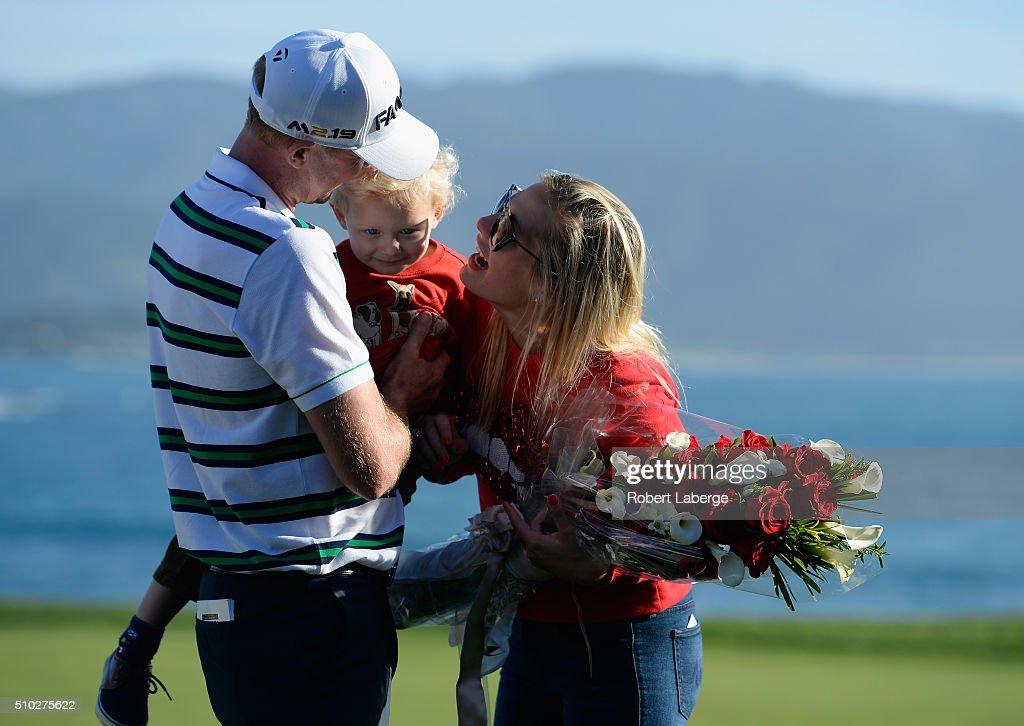 Vaughn Taylor celebrates with wife Leot and son Locklyn after winning the AT&T Pebble Beach National Pro-Am at the Pebble Beach Golf Links on February 14, 2016 in Pebble Beach, California.
