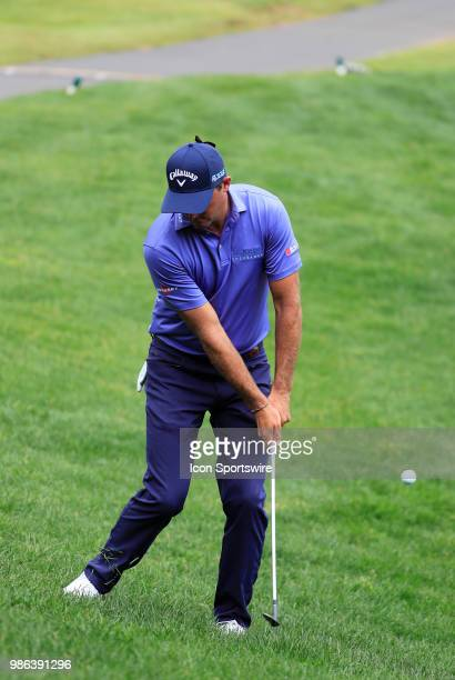 Vaughn Taylor of the United States chips onto the 16th green during the Final Round of the Travelers Championship on June 24 2018 at TPC River...