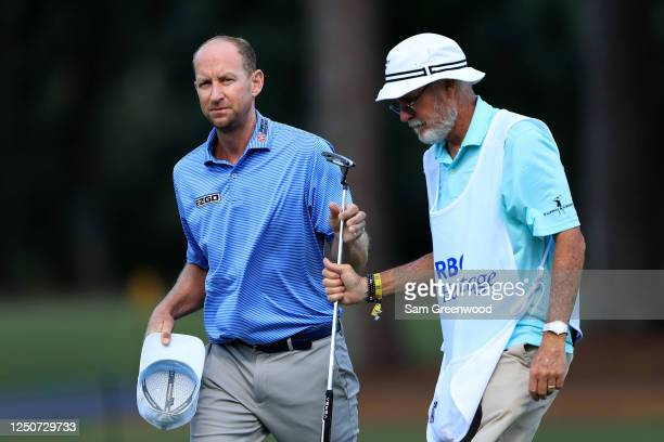 Vaughn Taylor of the United States hands his putter to his caddie on the ninth green during the second round of the RBC Heritage on June 19, 2020 at...