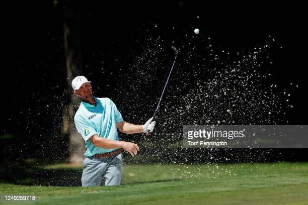 Vaughn Taylor of the United States plays a shot from a bunker on the eighth hole during the second round of the Charles Schwab Challenge on June 12...