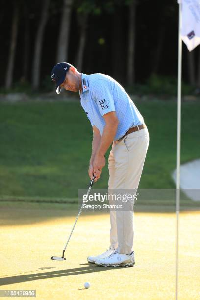 Vaughn Taylor of the United States putts on the 18th green during the continuation of the final round of the Mayakoba Golf Classic at El Camaleon...