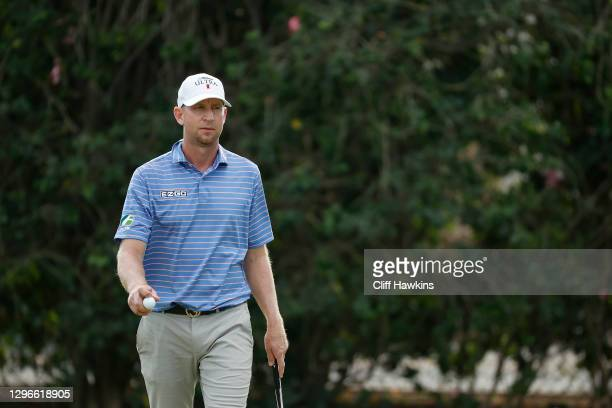 Vaughn Taylor of the United States reacts on the sixth green during the second round of the Sony Open in Hawaii at the Waialae Country Club on...