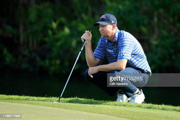 Vaughn Taylor of the United States reads a putt on the fifth green during the final round of the Mayakoba Golf Classic at El Camaleon Mayakoba Golf...