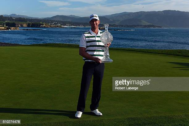 Vaughn Taylor poses with the trophy after winning the AT&T Pebble Beach National Pro-Am at the Pebble Beach Golf Links on February 14, 2016 in Pebble...